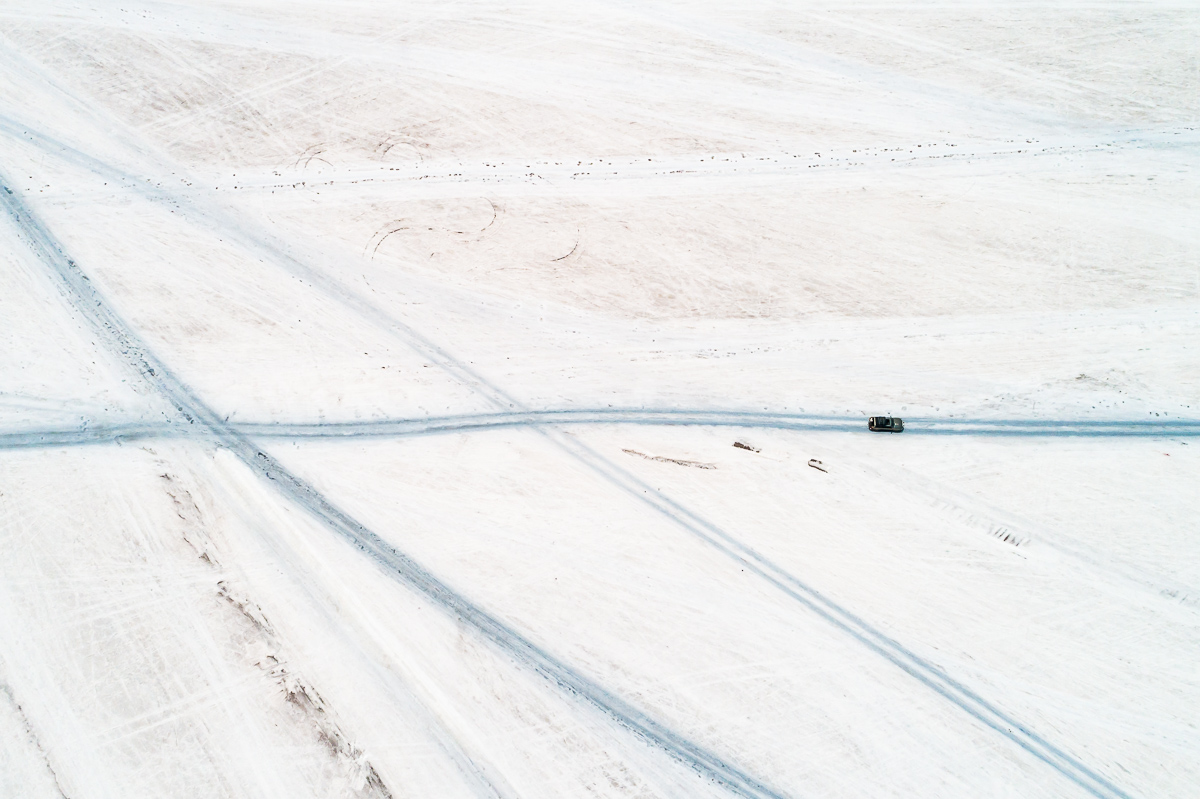 blue-white-salar-de-uyuni-salt-flats-potosi-bolivia-car-tracks-vast-expanse-desert-vastness-jeep-4x4-wheel-drive-road-roadtrip-south-america-drone-dji.jpg