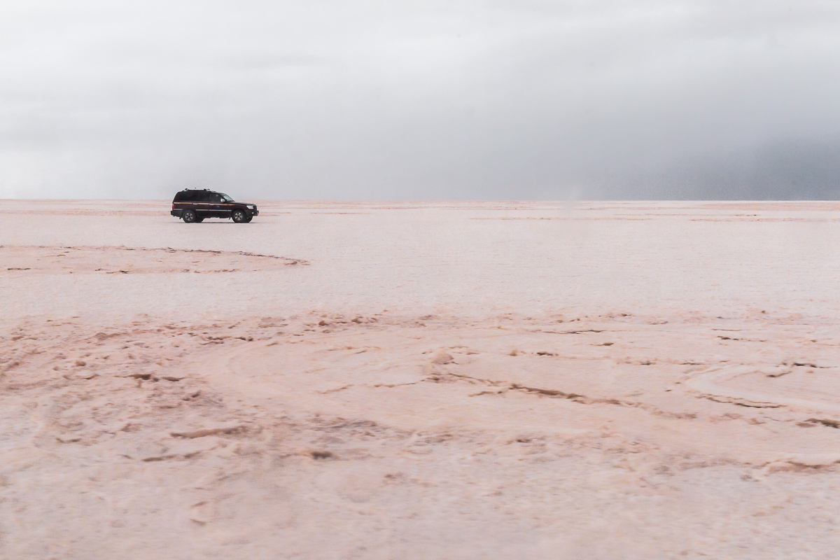 bolivia-bolivian-travel-trip-expedition-salar-de-uyuni-salt-flats-jeep-4x4-wheel-drive-car-vast-landscape.jpg