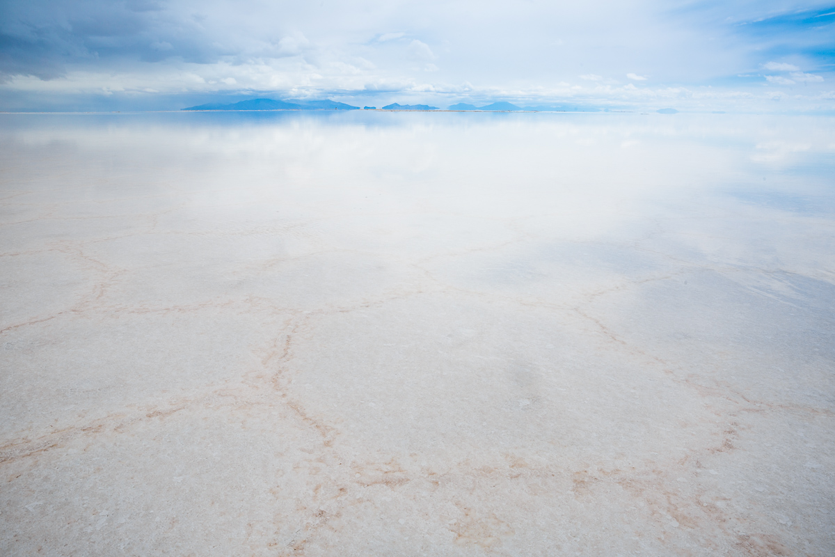 reflection-rain-salar-de-uyuni-potosi-bolivia-salt-flat-bolivian-mountain-reflected-sky-photograph.jpg