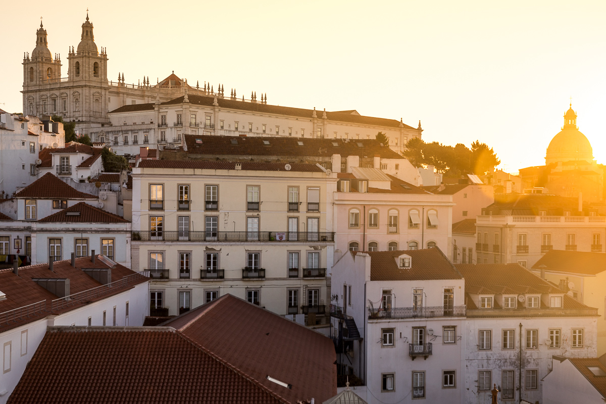 view-sunrise-miradouro-santa-luzia-portugal-lisbon-lisboa-yellow-light-landscape-photography-european-architecture.jpg