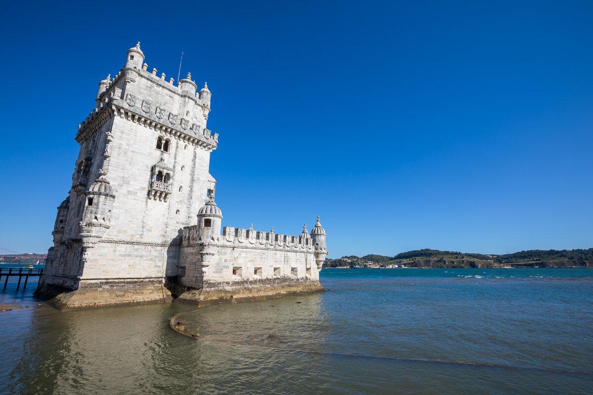 belem-tower-view-daytime-over-ocean-beach-water-bridge-travel-photography-blog-portugal-lisbon.jpg