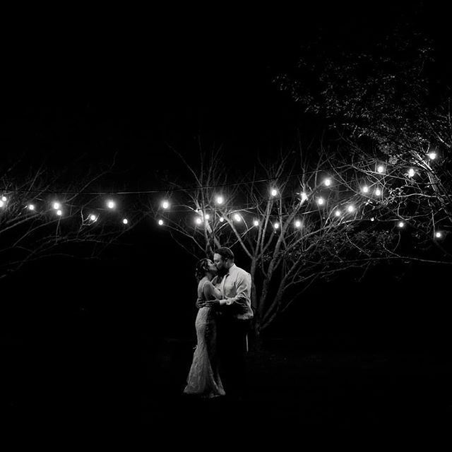 Can it get any more romantic!? A few minutes under the lights as the rain comes down. Your guests waiting to drag you back to your dancefloor! . . . . @heritageprairiefarm @stephanie_olsen_19 #farmwedding #heritageprairiefarm #blackandwhitephotography #nightportrait #illinoisweddingphotographer #weddingphotographer #weddinginspiration