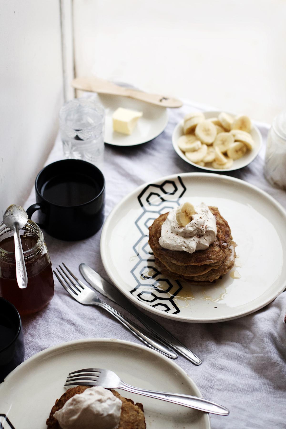 Brown Butter Banana Oatmeal Pancakes w/ Peanut Butter Whipped Cream + Honey (gluten-free + refined sugar free) | Ruby Josephine