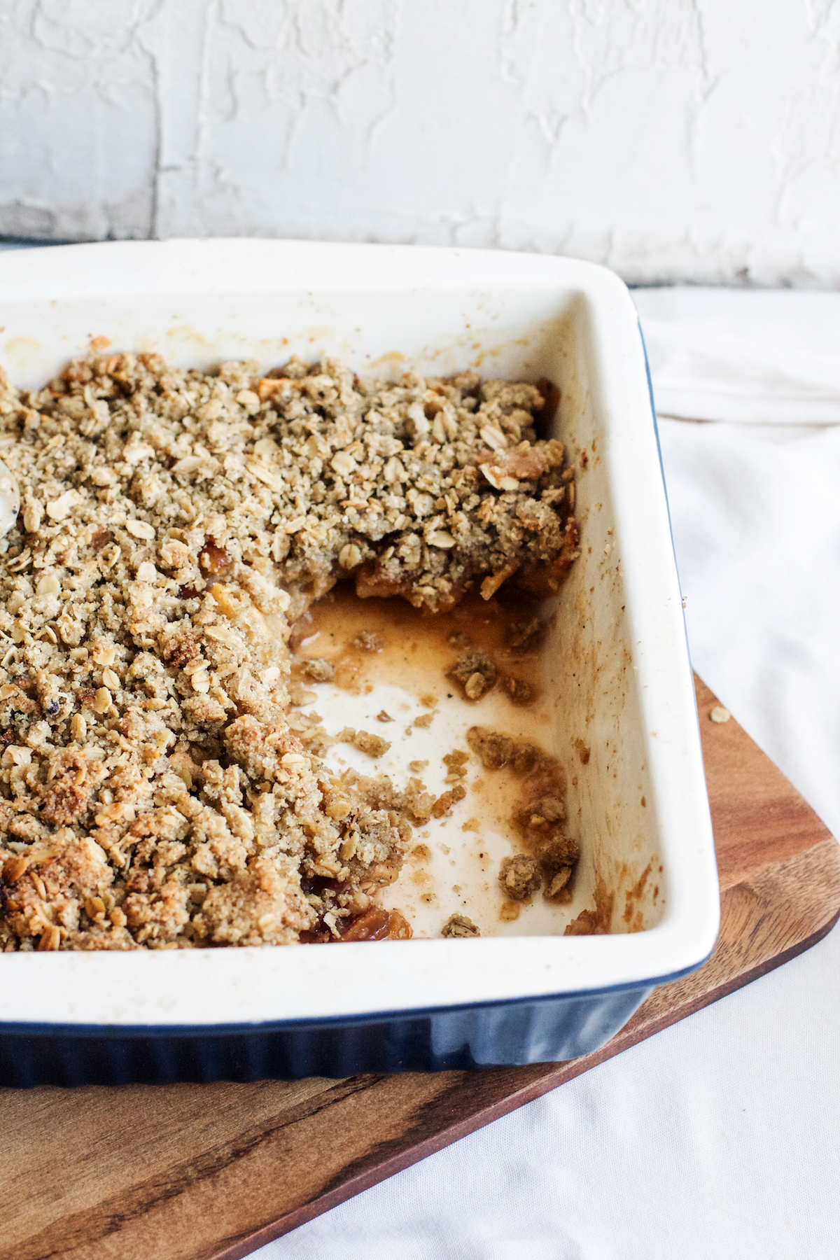 Chai-Spiced Date + Apple Crisp {gluten-free}. The perfect cozy dessert for fall! Made a little healthy-ish with maple syrup + millet flour. Recipe + photo by Ruby Josephine