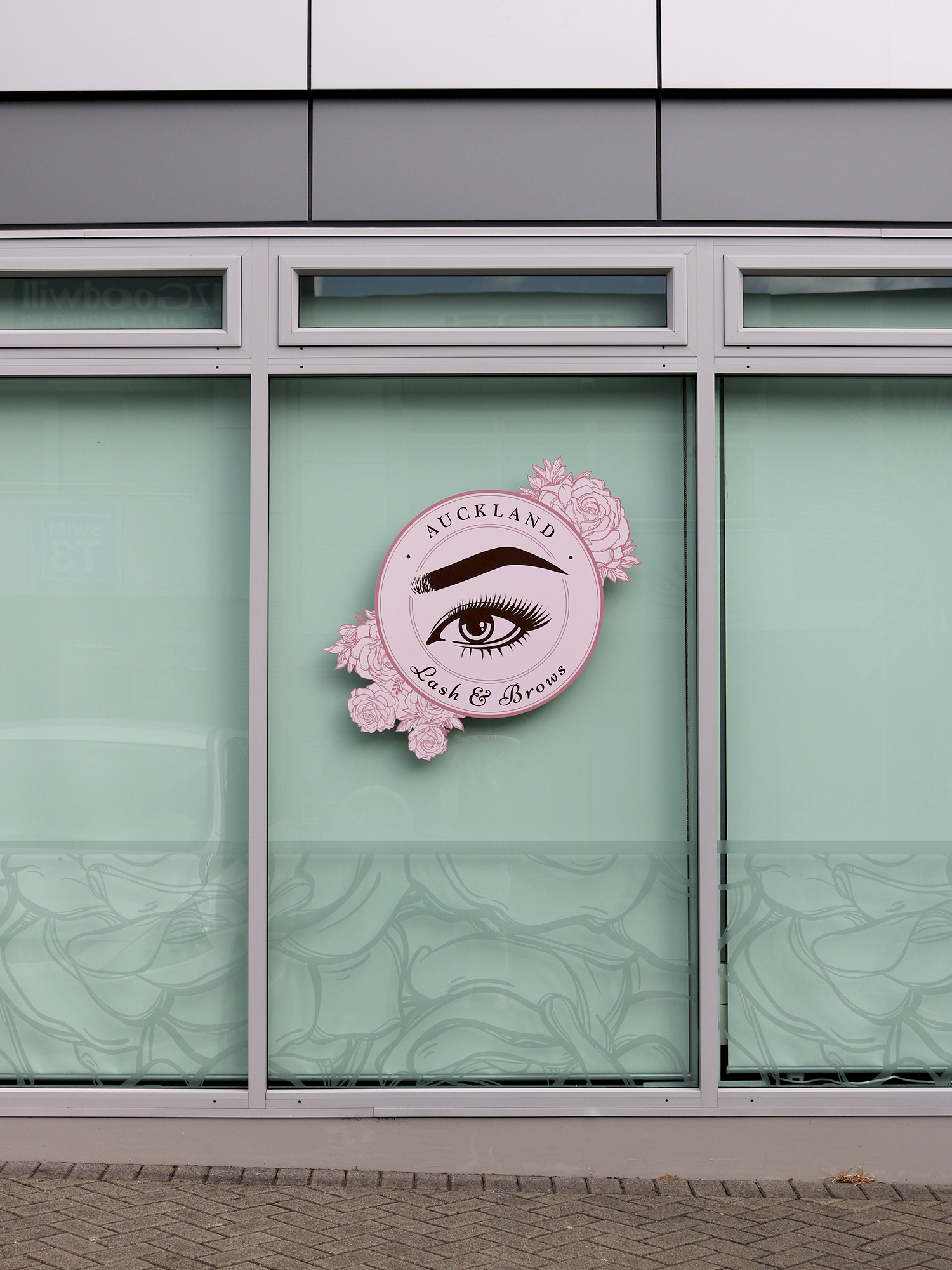 Window signage on the side of the building designed by  Design by Cheyney . Printed and applied by  Speedy Signs