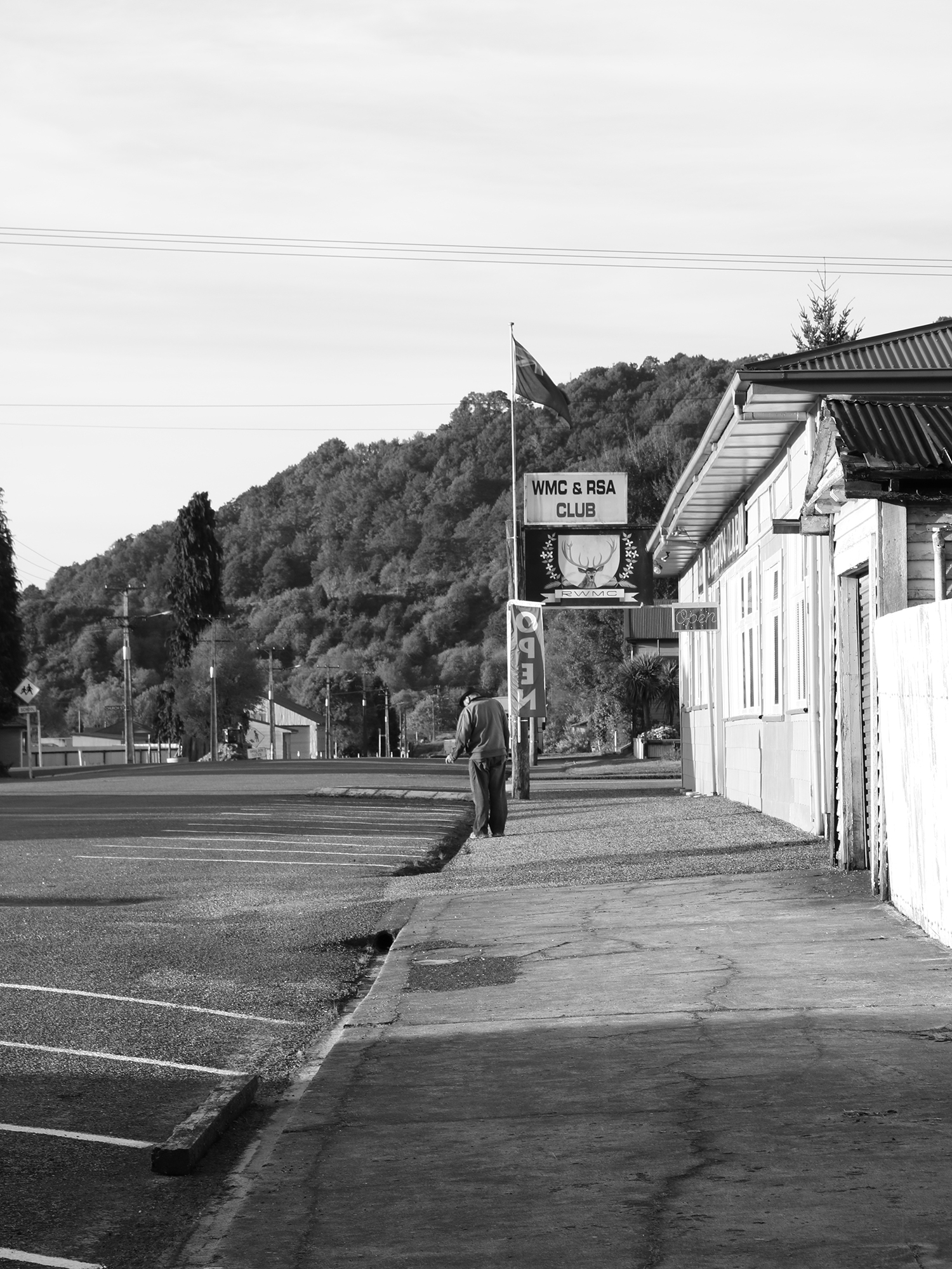 Man outside the RSA in Reefton, South Island, New Zealand