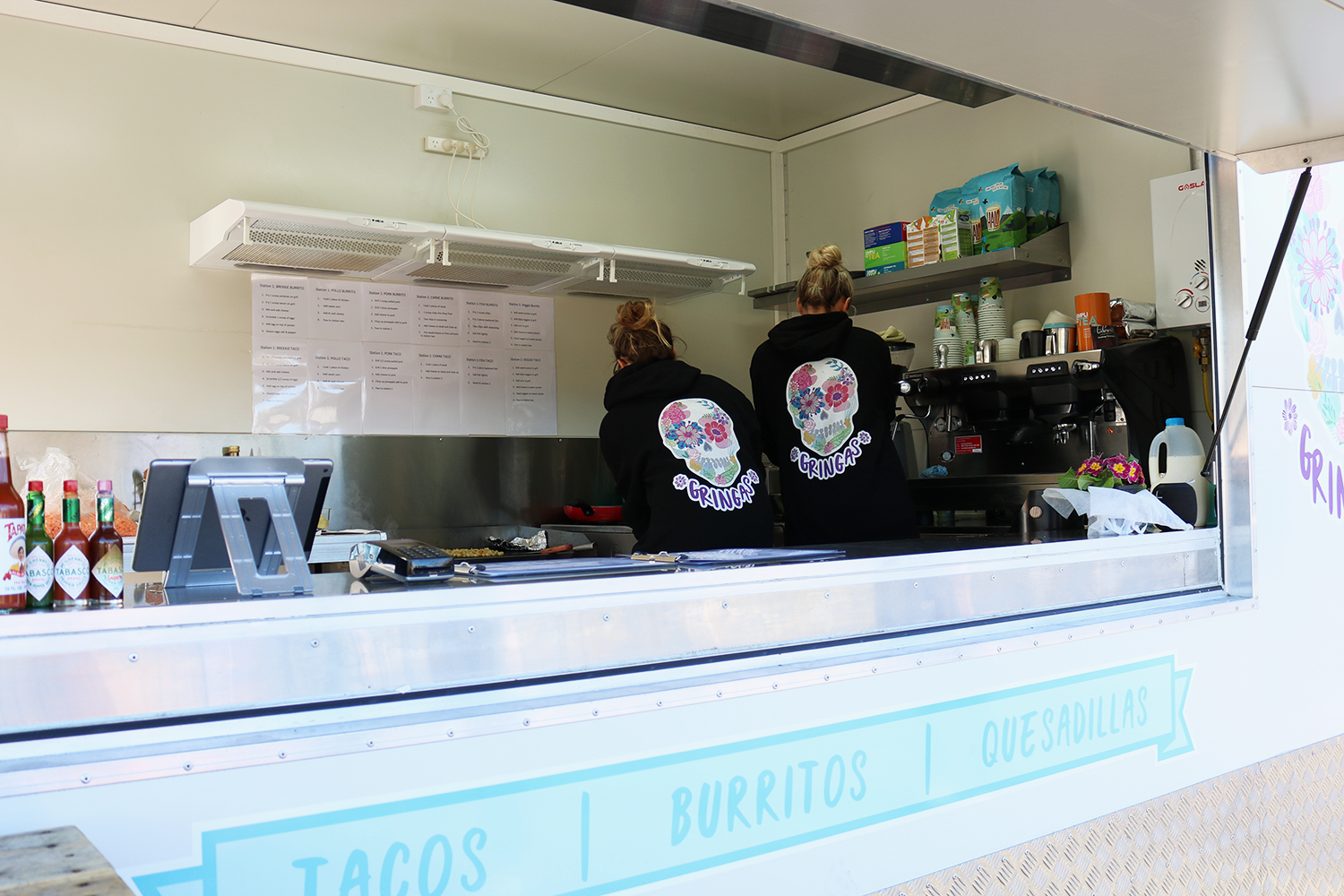 Maggie & Deena busy in the truck serving up some delicious Mexican-inspired flavours