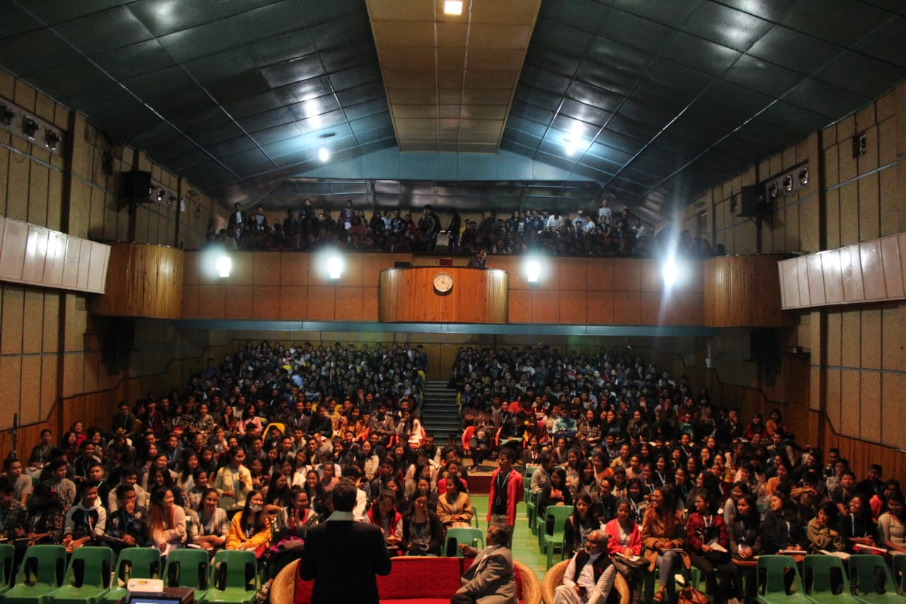 "Delivering a session on ""Leading with Purpose"" to an audience of 1,000 students at St. Anthony's College in Shillong, India."