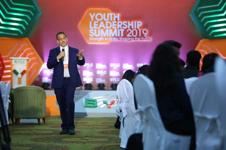 "Delivering a session on ""Finding Your Career Path"" to 350 participants at the 2019 Bangladesh Youth Leadership Summit in Dhaka, Bangladesh."
