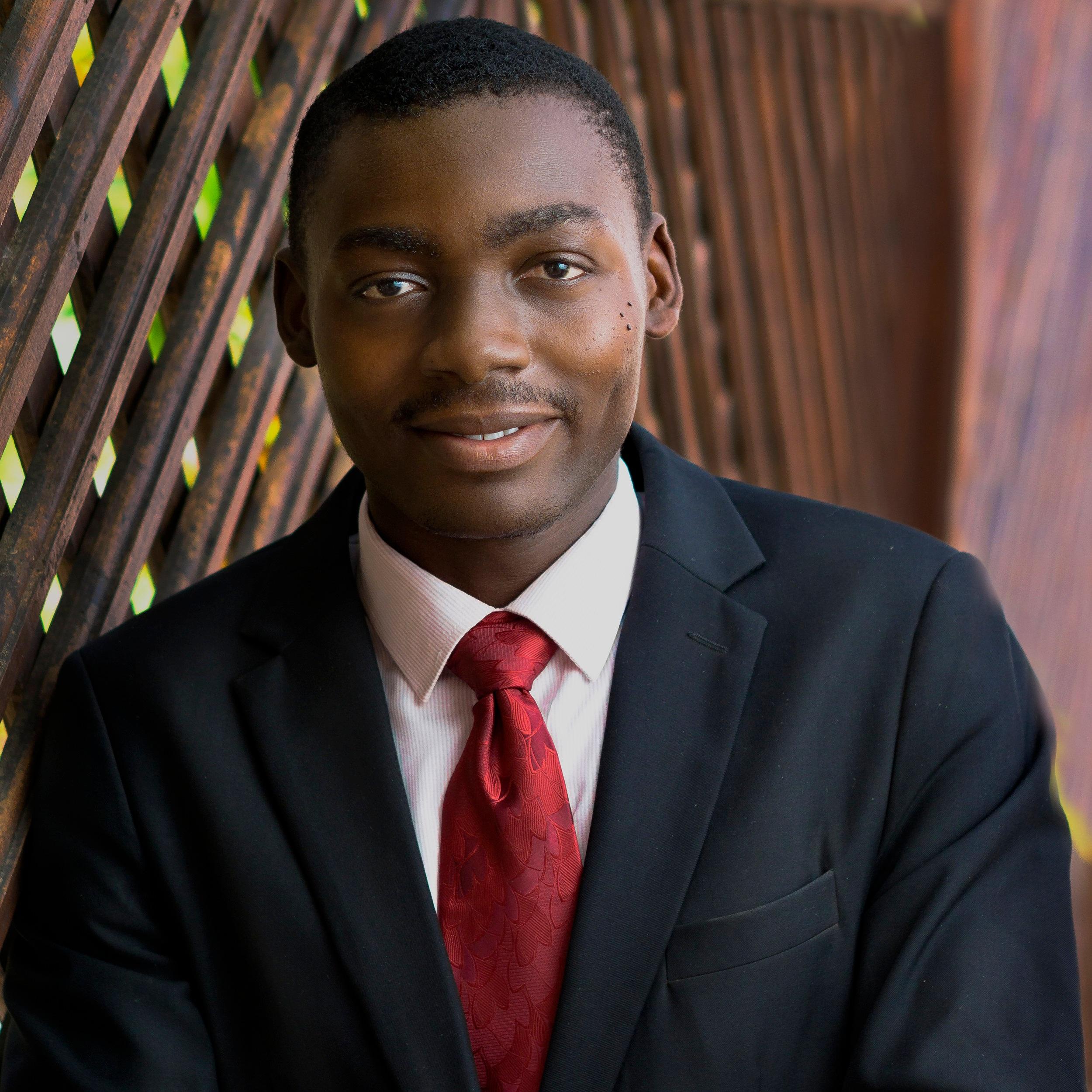 Justice Adu   Associate