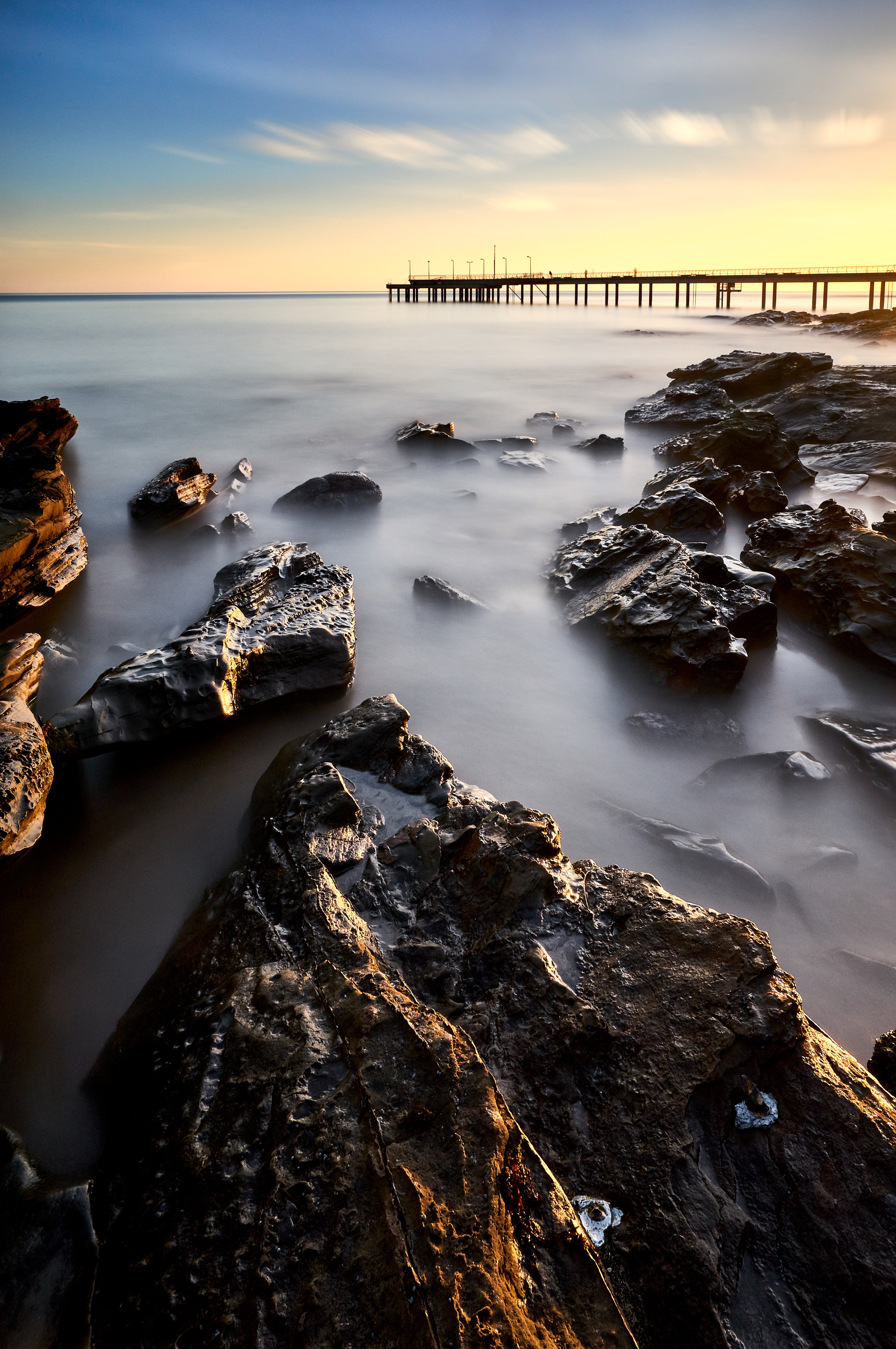 Rocks @ Lorne Pier | Feeling the warm sun slowly push away the chill of an early morning, and watching as it lit the edge of the stones in gold, was almost a spiritual experience, made more profound by the softness of the ocean in the final image.
