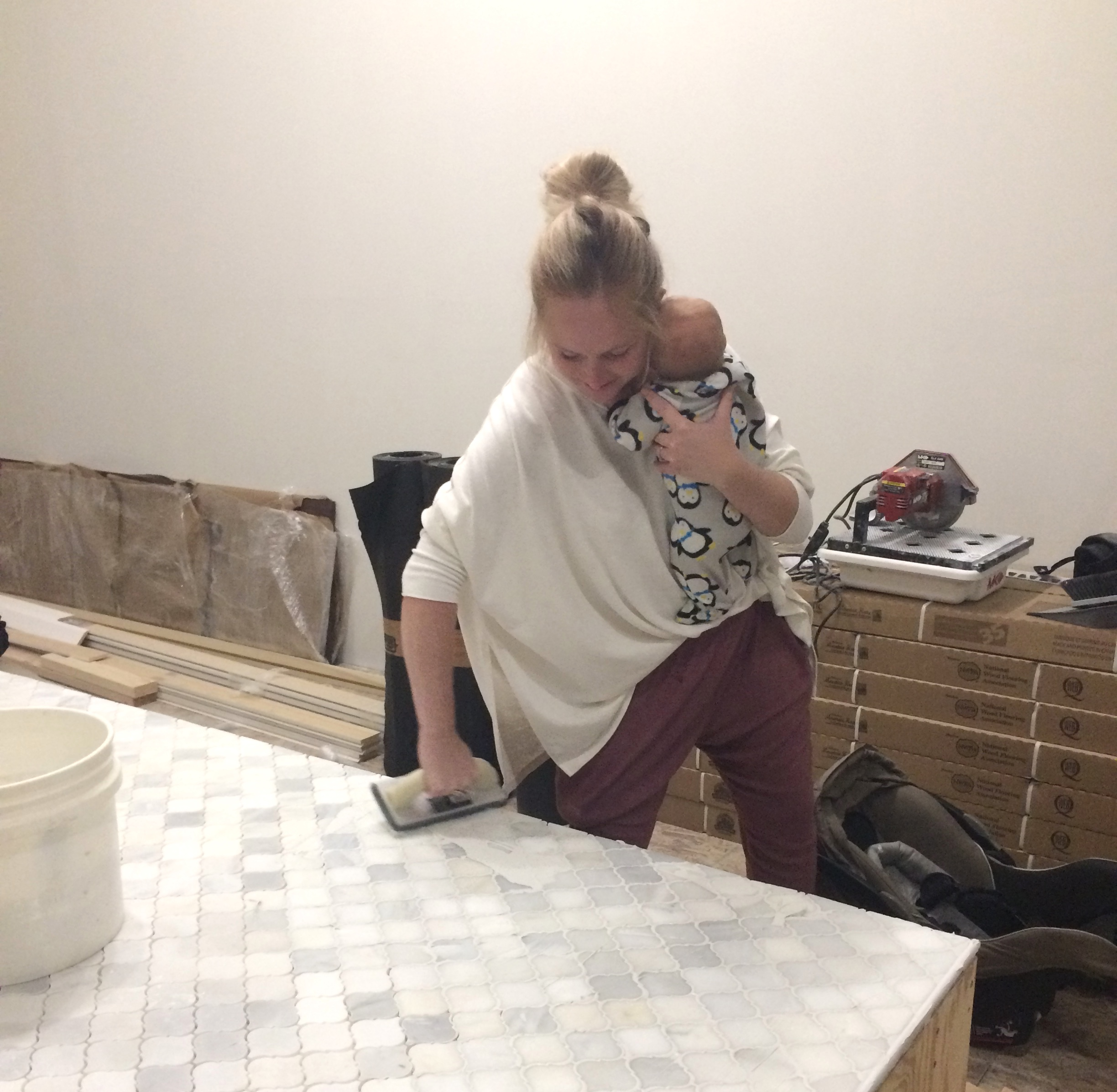 Samantha with her 3rd baby, Dax. He spent a lot of time helping us build the store. #ShopBaby