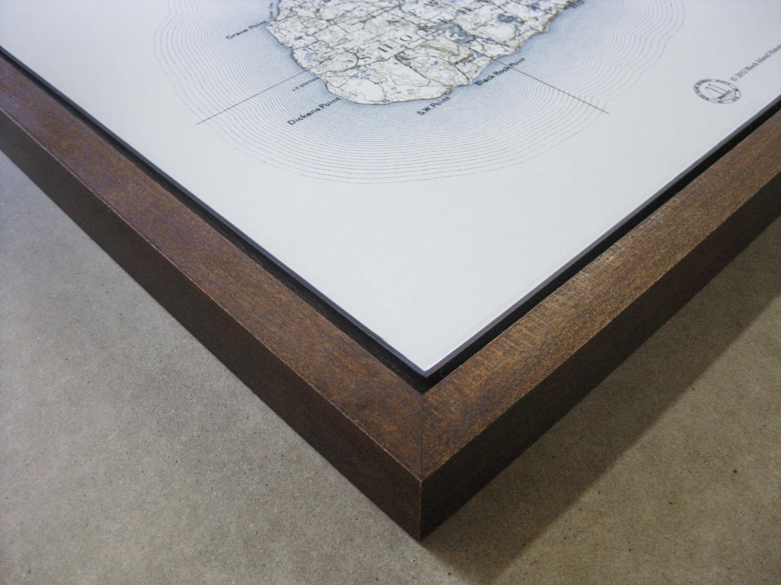 Corner detail of a float frame, walnut stain on oak