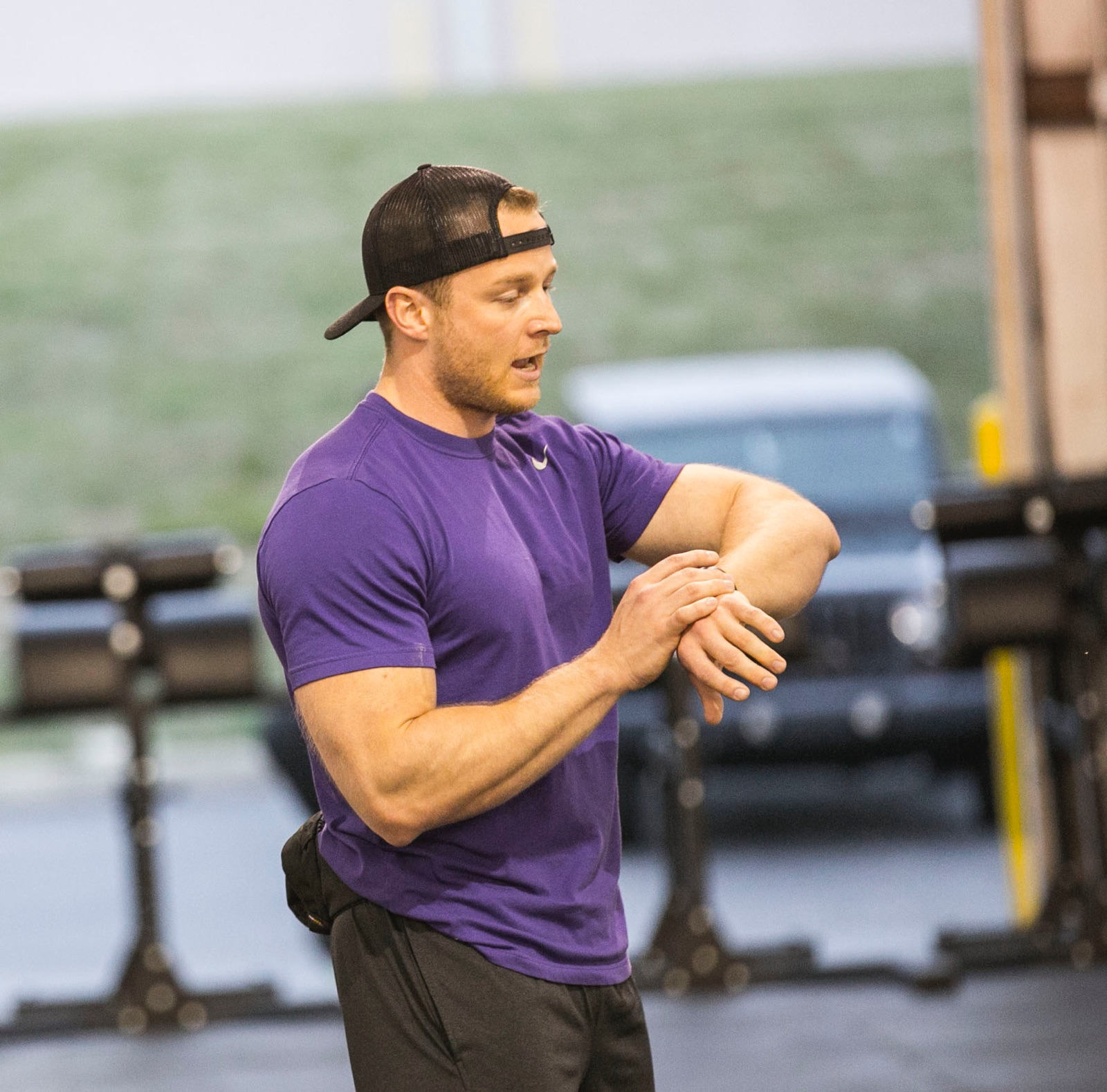 """Coach/Owner Tom started CrossFitting a mind-boggling 13 years ago while he was deployed in Afganistan as a special operator. """"I found CrossFit to be the most effective way to maintain a high level of operational readiness,"""" he says.  Toms' passion is changing his members' mindsets in their approach to life, including accepting adversity for what it is: an opportunity to grow instead of another hurdle to jump. """"I love helping members change and extend their lives,"""" he says. """"I also love adapting people to a different mindset and approach to life. I love seeing people own their current fitness and making a commitment to do something about it.""""  When Tom isn't in school, you can find him hanging out with his wife, Deb, hitting the books in law school, or picking out which fanny pack to wear for the day.  CERTIFICATIONS: Bachelors Degree Juris Doctorate CrossFit level 1 certified coach CrossFit level 2 coach OPOTA certified"""