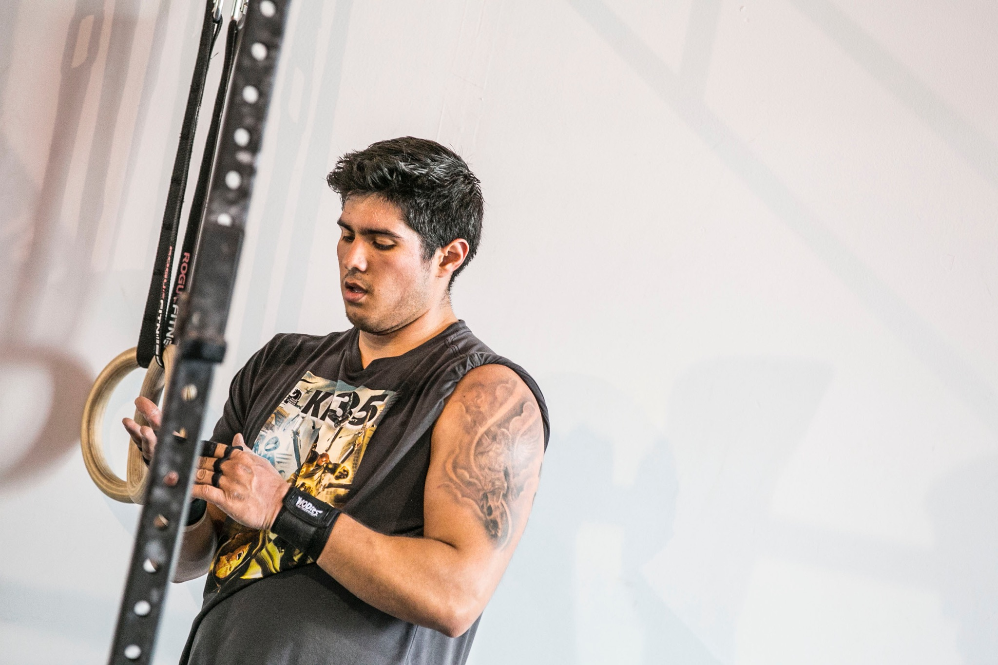 """Coach Noah Garcia played football for 11 years, and he started CrossFit to keep up the rigorous exercise he got accustomed to playing football. """"I peaked in high school (500 lb. back squat, 280 lb. power clean),"""" he says. """"I'm just trying to get back to my former glory.""""  Noah is passionate about pushing past the physical limits people set for themselves, and he loves seeing members be able to do movements or weights they didn't think they could before. When he's not CrossFitting, you can find Noah throwing axes, riding motorcycles and cooking.  His favorite quote is """"The harder you work, the luckier you get.""""  CERTIFICATIONS: CrossFit Level 1 American Council on Exercise Personal Trainer Certified"""