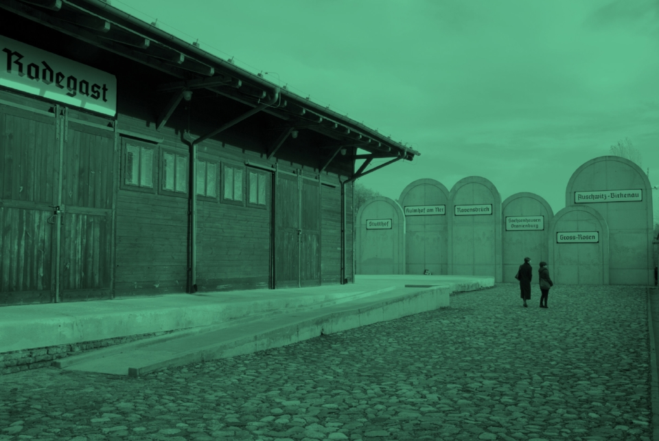 Lodz, Poland-November 11, 2012: Two women are sightseeing the memorial of Radegast Station at Lodz city in Poland