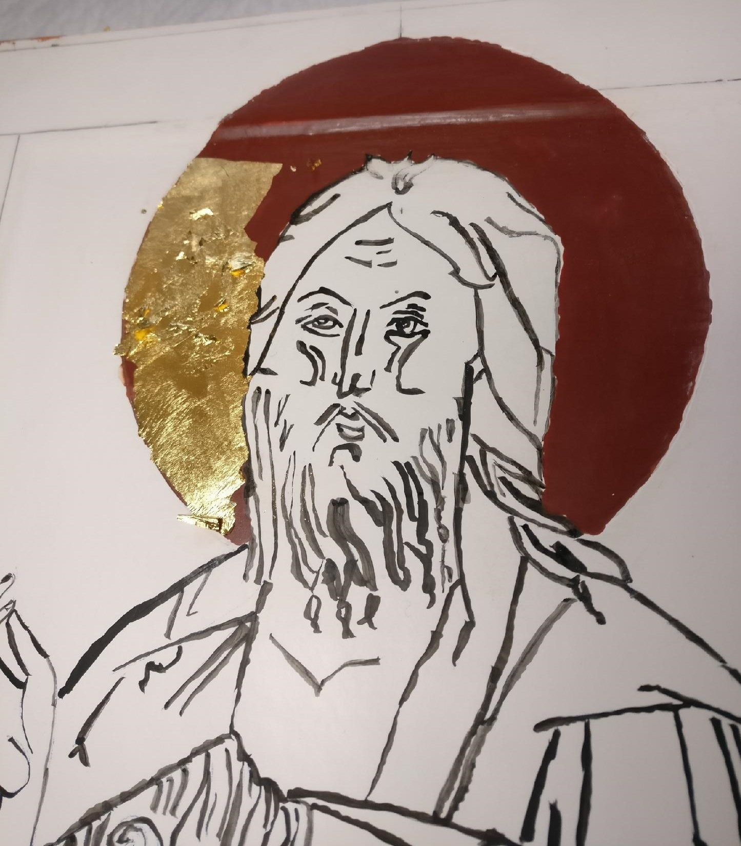 John the Baptist Icon, adding gold leaf on clay.