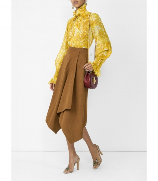How gorgeous is this Sonia Rykiel silk georgette blouse? For me it is the epitome of daytime chic. I love it worn with camel tones as shown here