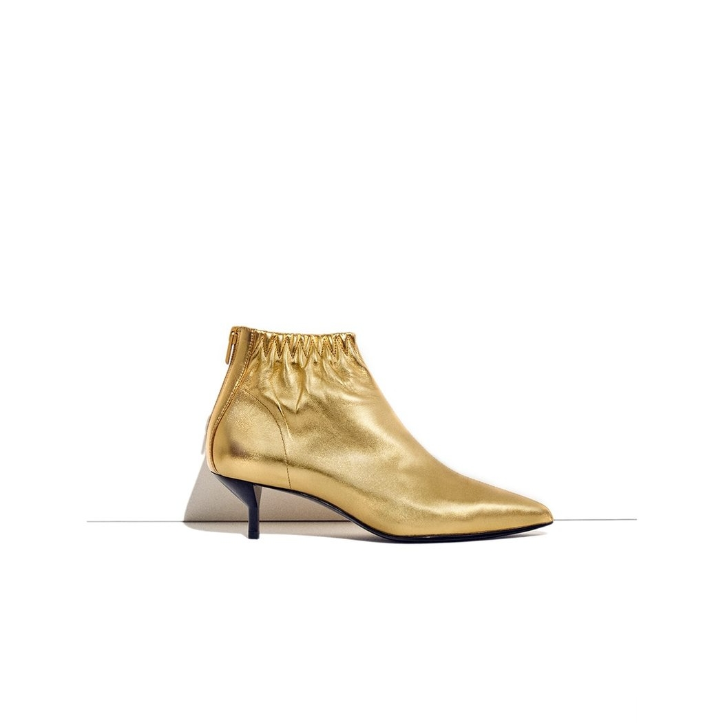 These gold booties by Philip Lim with their kitten heel and pointed toe pack serious fashion punch and yet don't compromise on comfort one bit!