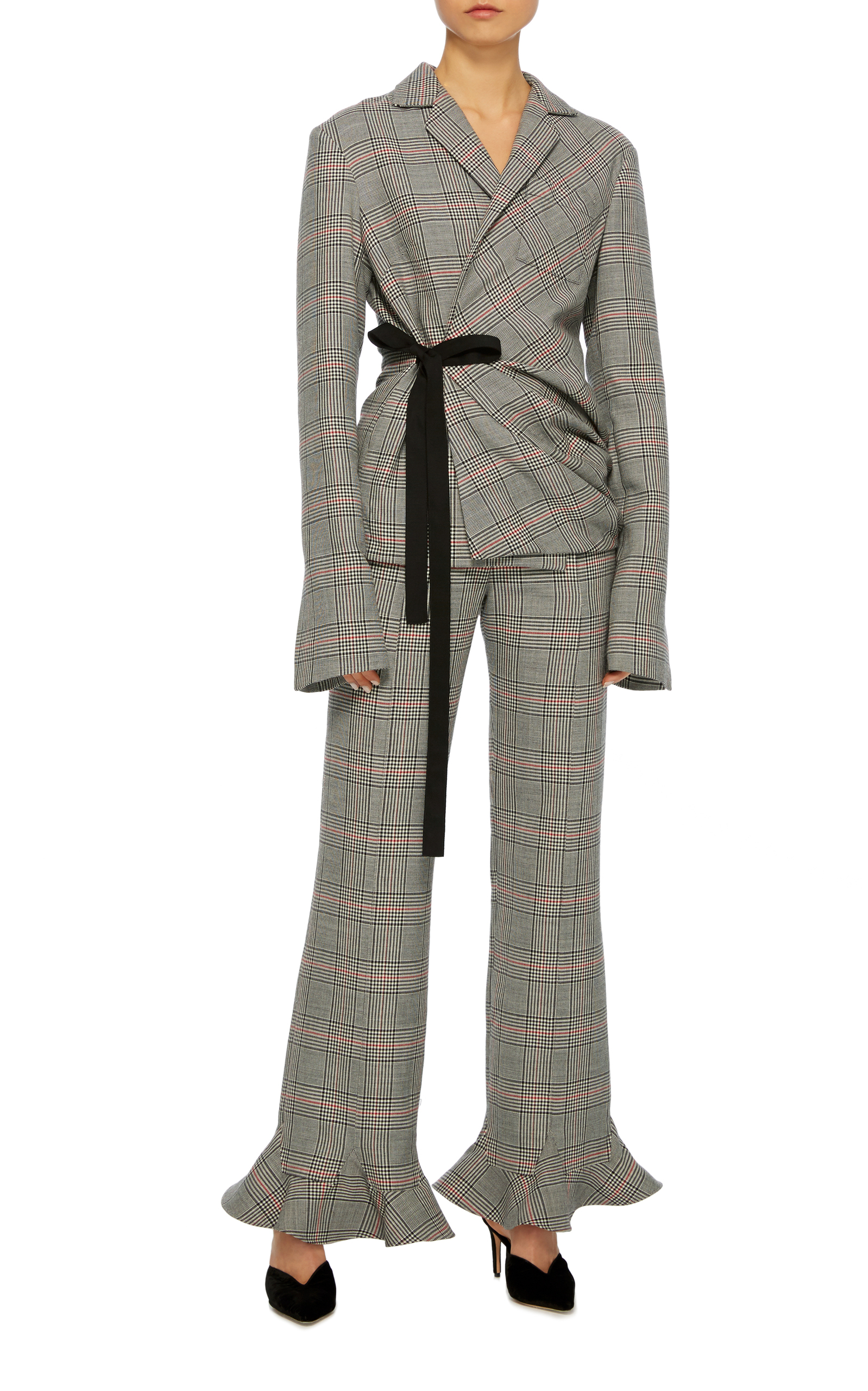 This Rosie Assoulin suit for me is the perfect balance of masculine and feminine. A masculine concept and print but with soft shoulders, exaggerated sleeve lengths and frill trouser cuffs a girl can wear these pieces a million ways and always look amazing.