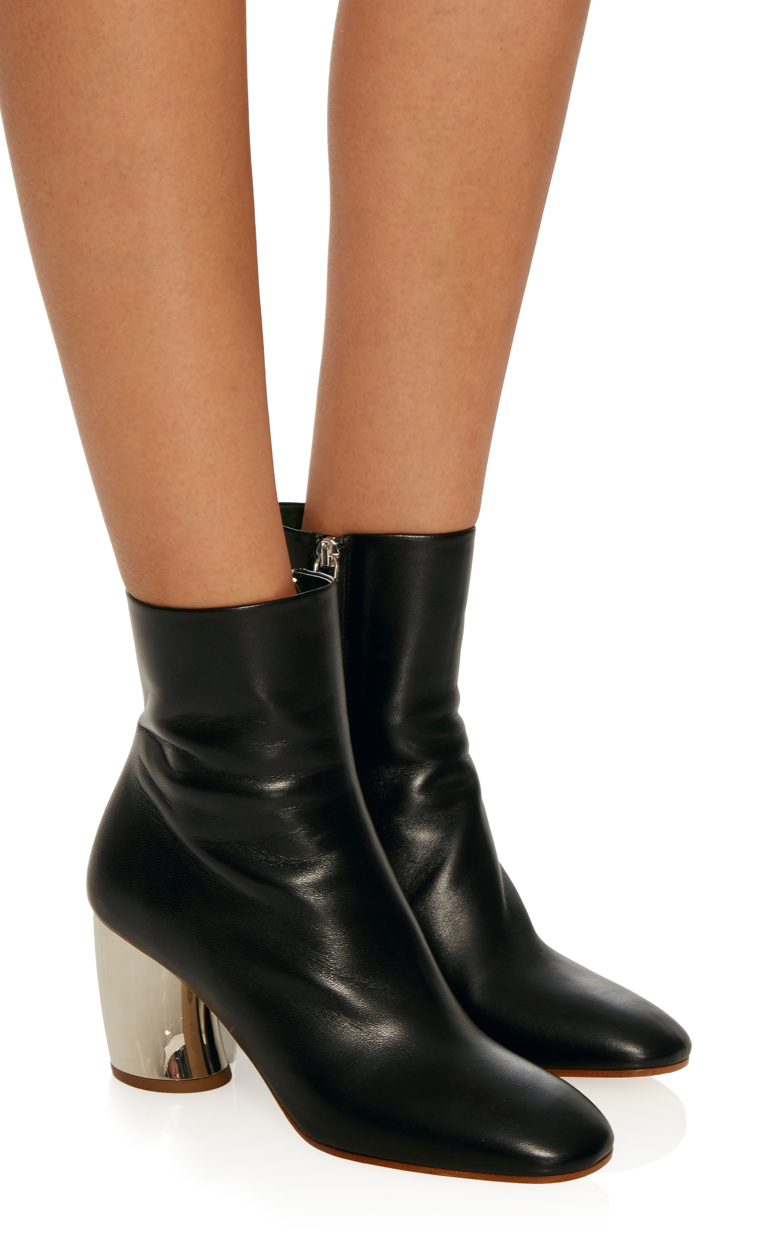 These ankle boots are perfect for all of the trousers options. High enough to just tuck under the cuff or leave the perfect amount of skin showing. With a block heel these Proenza Schouler boots are super comfortable and the soft leather stands up to winter conditions.