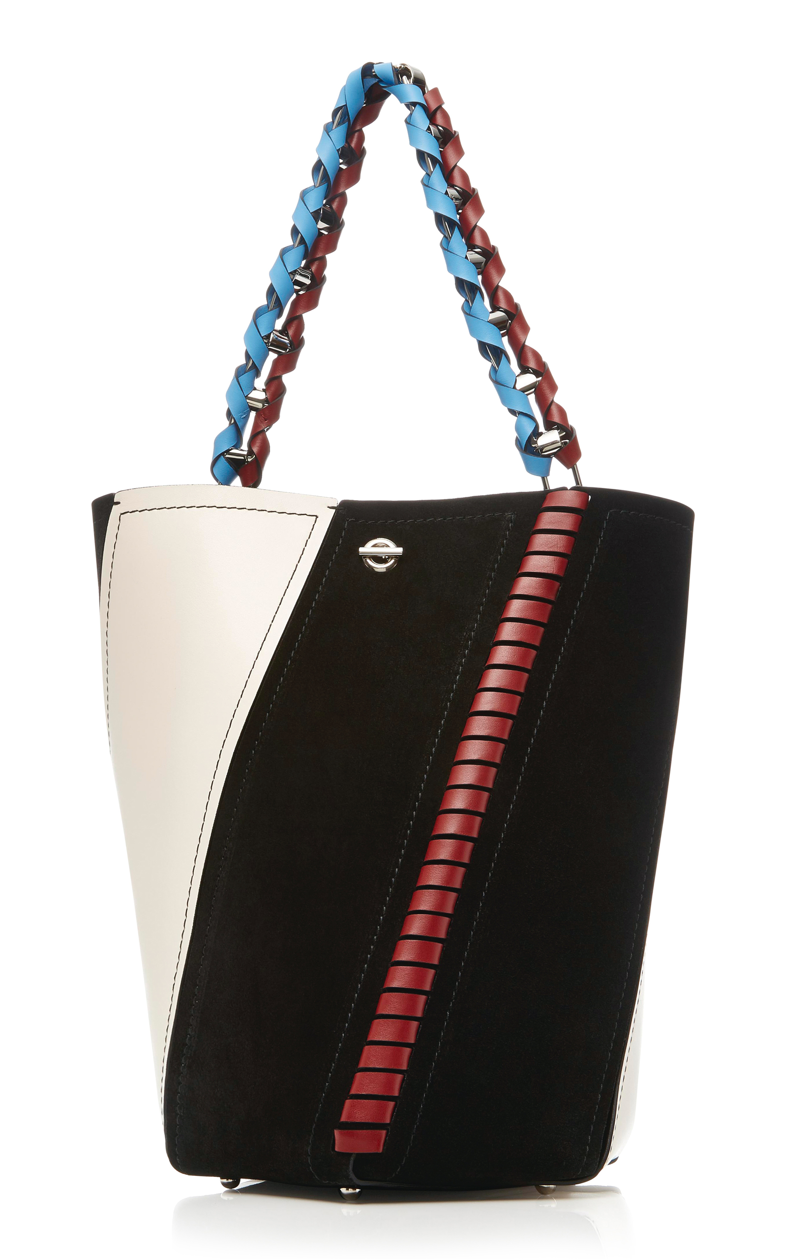 This Proenza Schouler bag (I told you...)is a great option for the busy woman on the go. A great size and incredibly versatile with touches of blue and red on a black and ivory base. The different finishes bring extra interest and ties the bag into almost every outfit you can dream up!