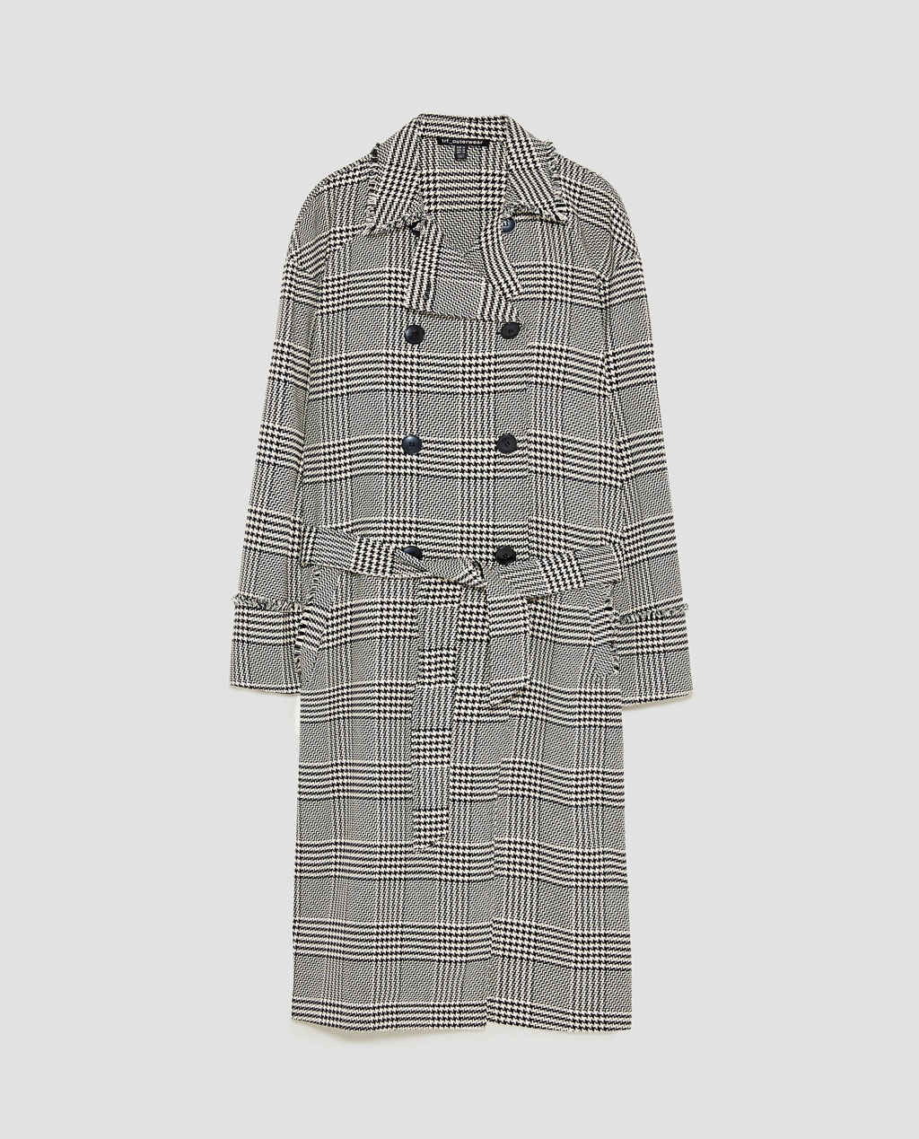 I usually pair contrasting scales of checks but there is something about this matching check on check look that I find quite striking. Wear the coat draped over the suit for lots of drama, properly buttoned over jeans or slightly buttoned with scrunched sleeves over the knit for a bit of nonchalance.
