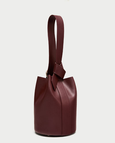 This bag is super cool and equally versatile. With a quick shift of the straps, the sack shaped bag becomes a backpack. How cool?! Day or night, this bag will make your outfit pop.