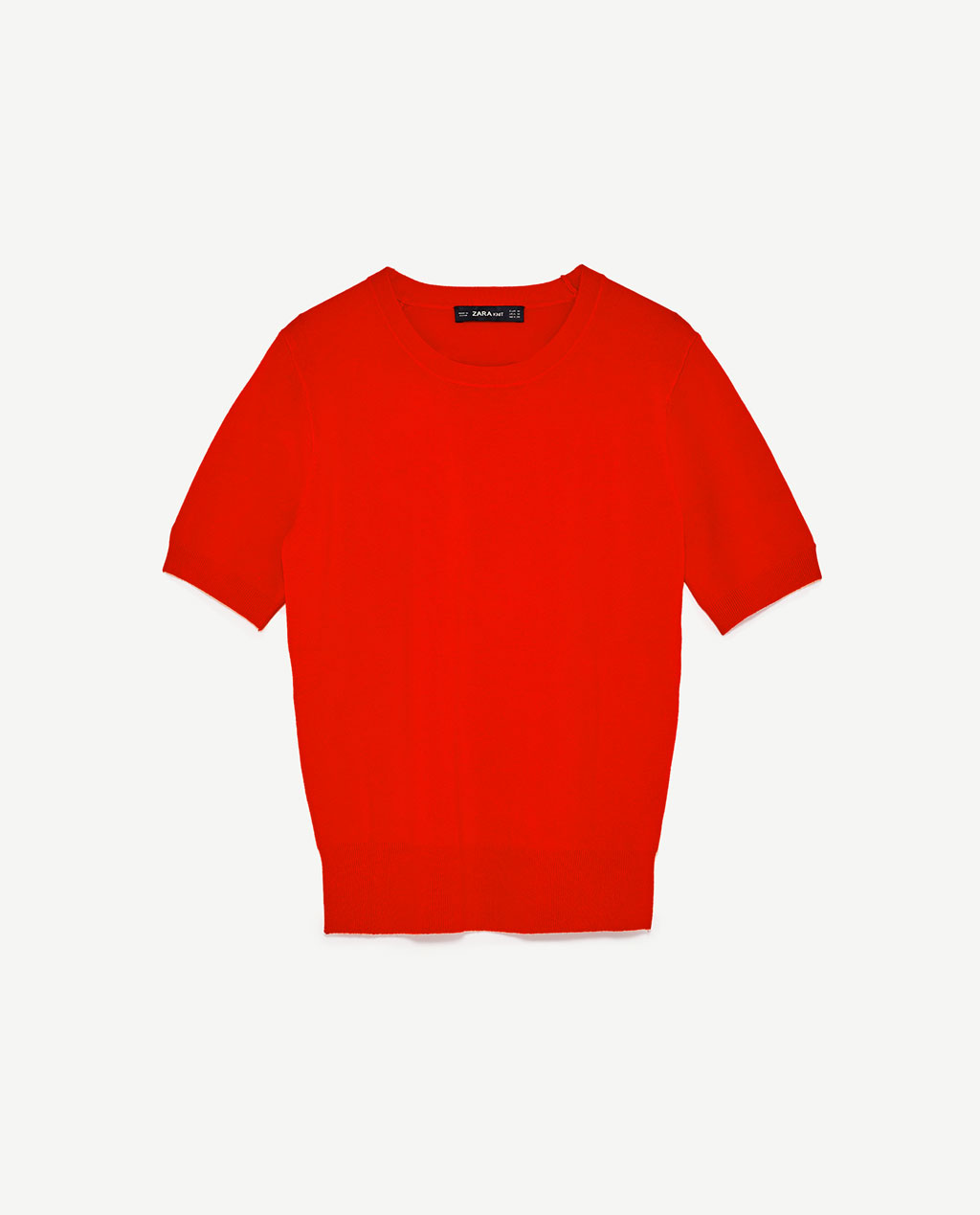 This basic short sleeve knit with the right amount of fit and in bright tomato red is a great basic. Jazz it up with cool accessories or with the blazer on top.
