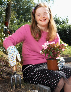 Girl with Downs Gardening