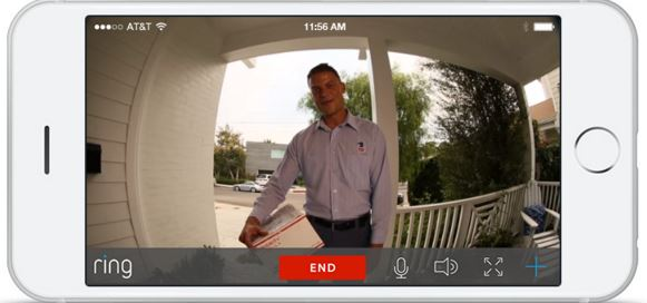 Image: A smartphone shows the Ring app, revealing a postman at the door delivering a package.