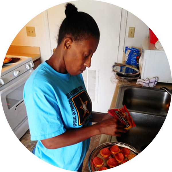 Pearlie prepares a snack in her kitchen