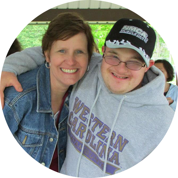 David poses for a picture with his mother.png