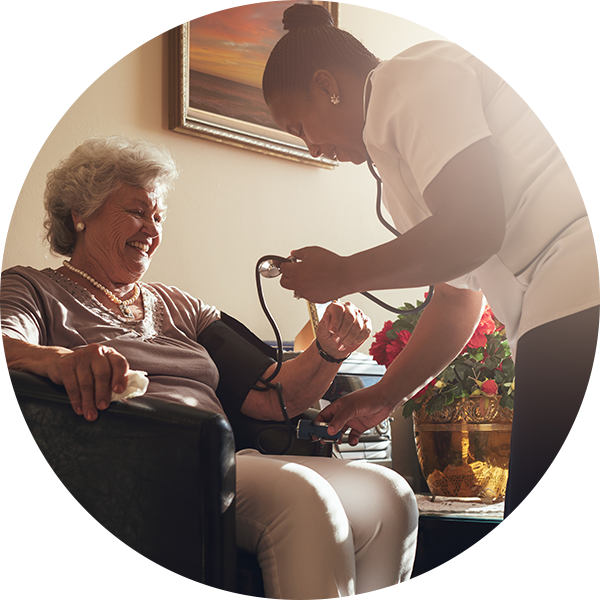 A nurse takes the blood pressure of an elderly woman