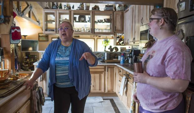 Photo by Michael Penn / The Juneau Empire: Gina and her mom talk in their kitchen.