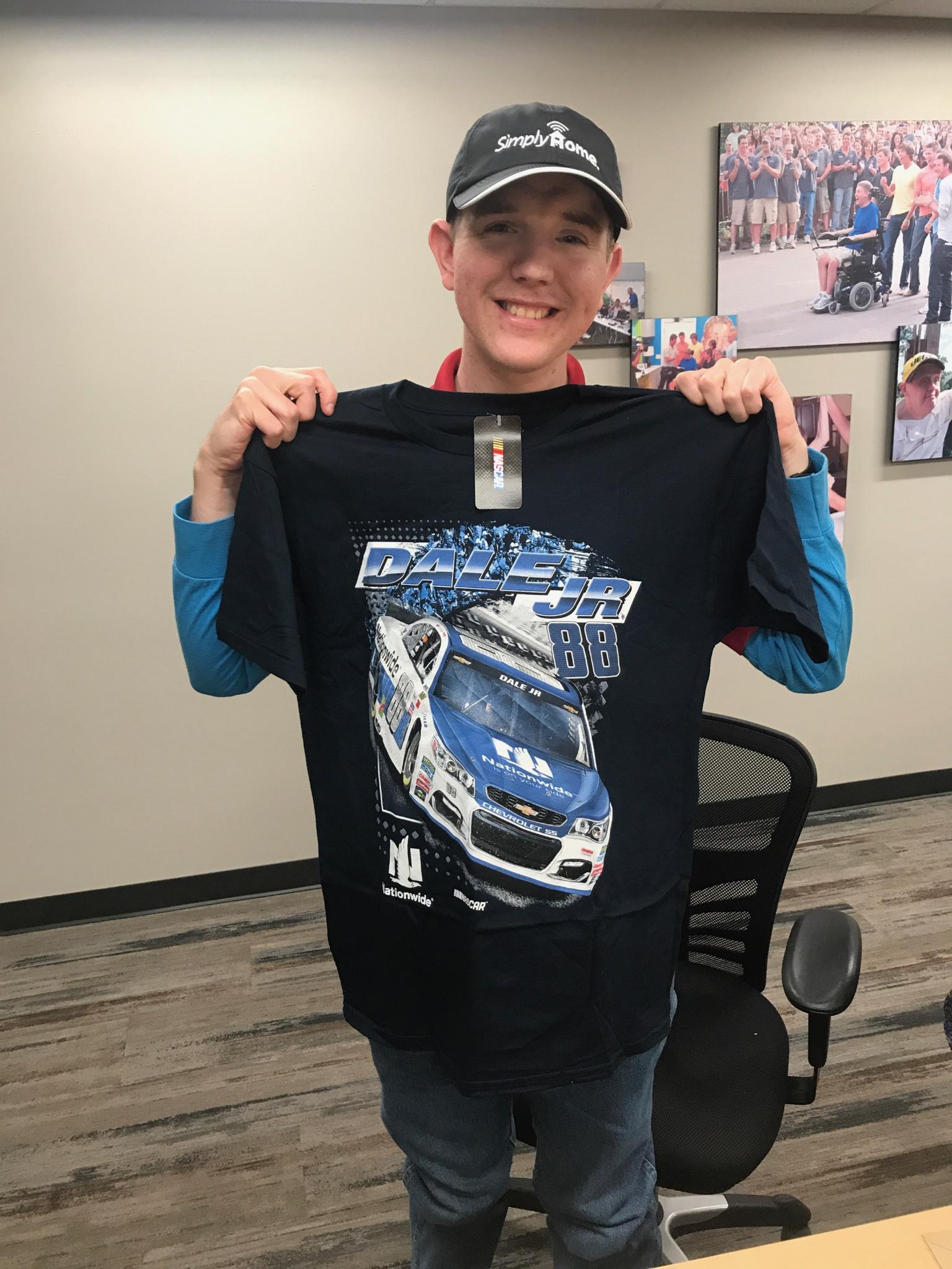 Bryan holds up a Nascar t-shirt.jpg