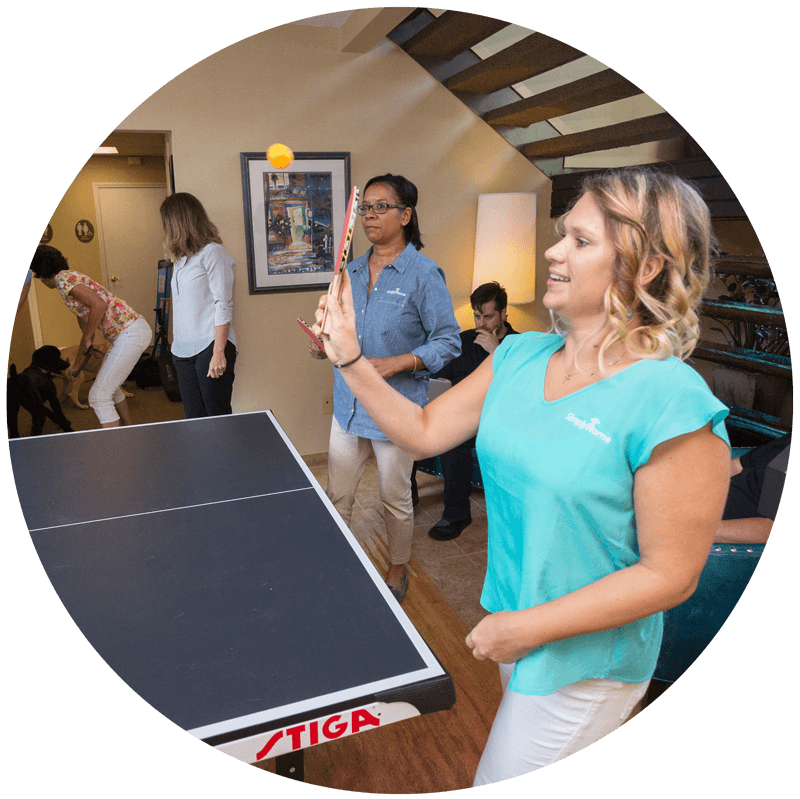 SimplyHome Staff Playing Ping-Pong