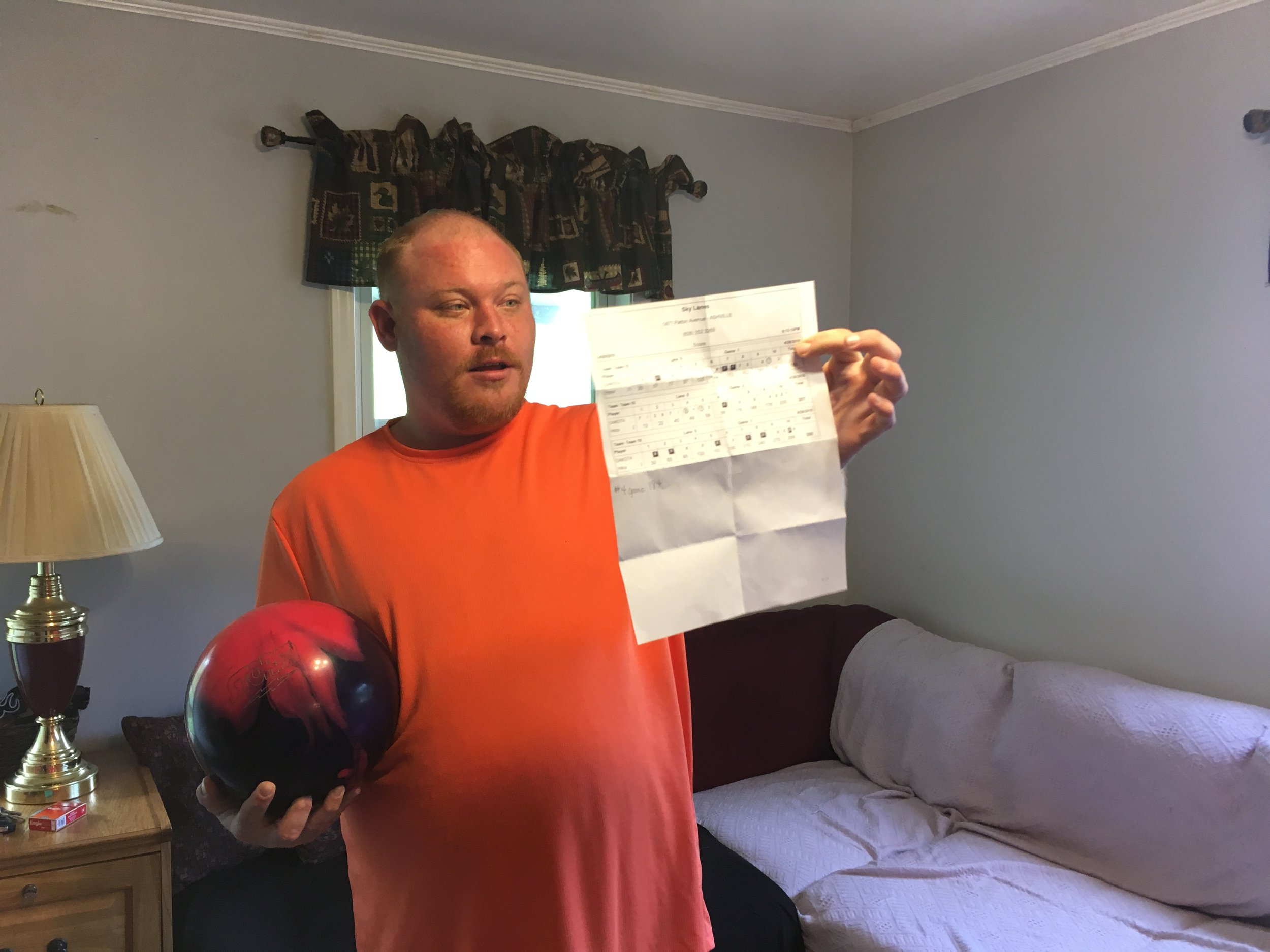 Dakota shows off his custom bowling ball and discusses his new high score – a 300!