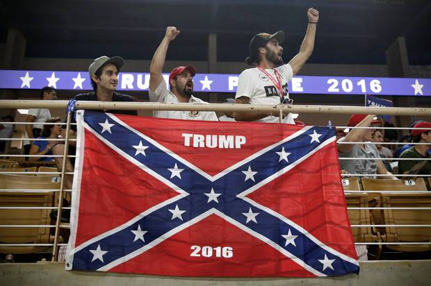 Three supporters cheering behind a confederate flag at a Trump rally in Florida (Aug 2016).