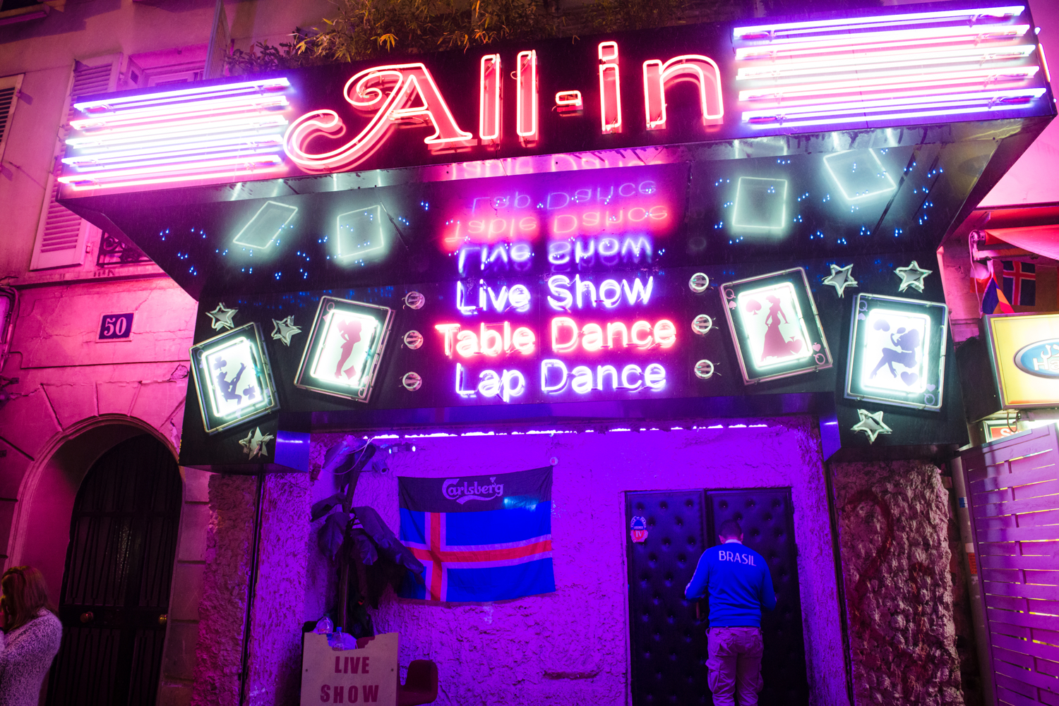 France, Paris. A strip club in the Pigalle district of Paris uses the Icelandic flag to attract visiting tourists the night of the match between Iceland & Austria in the Euro Cup. During the Euro Cup held in France, Pigalle, a popular district with bar, strip clubs and sex shops, saw large numbers of foreign supporters. Bars & strip clubs would typically hang flags of the opposing teams attempting to attract tourist clientele.