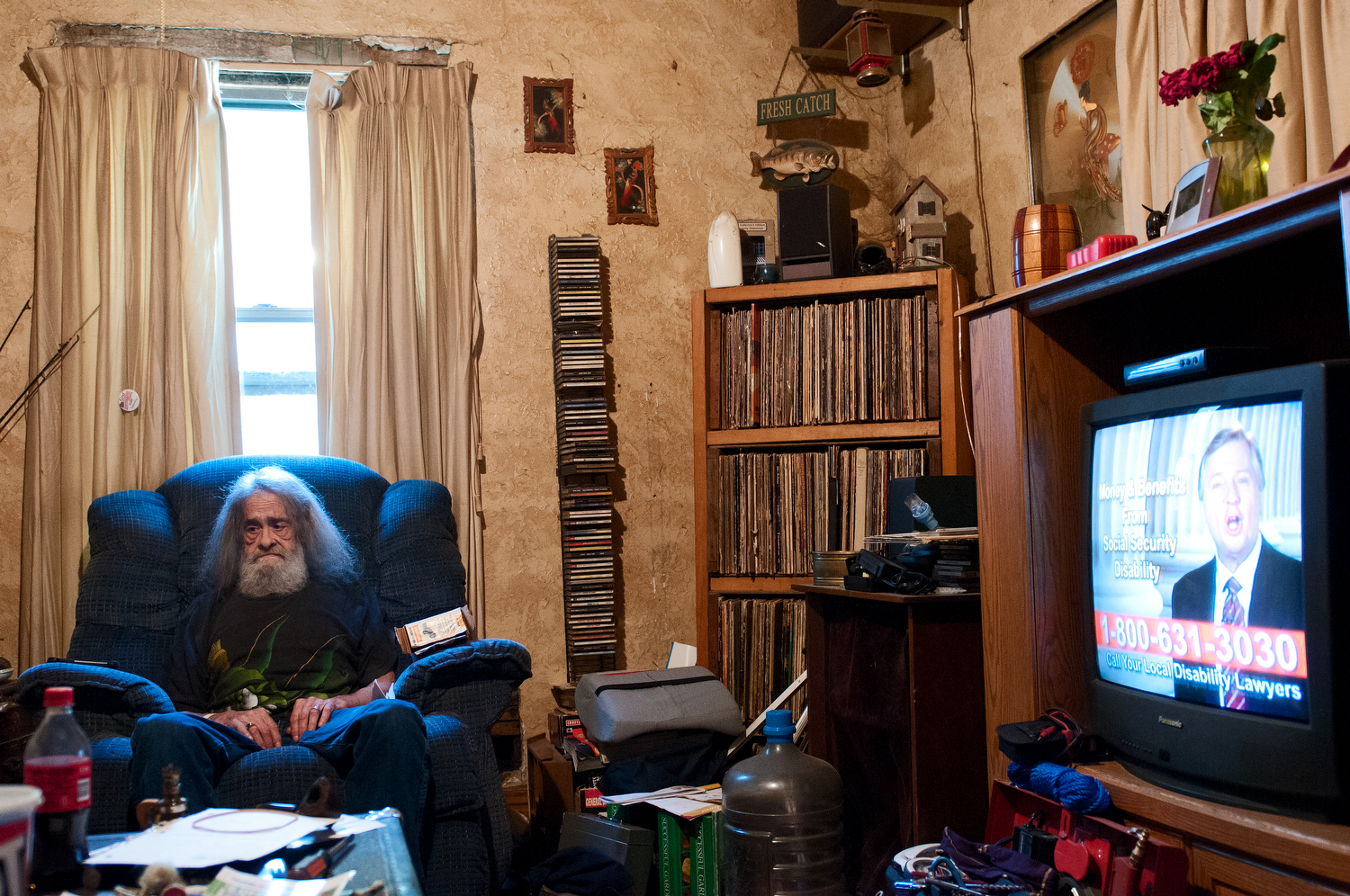 United States, Missouri, Kansas City. Former GST Steel worker Vernon Corliss sits in his Kansas City home. Corliss is a former worker at GST Steel, a manufacturing plant closed by Mitt Romney's venture capital firm Bain Capital. He did not lose his job when the plant closed, however when GST Steel declared bankruptcy it could no longer fully pay his pension and health care benefits. Corliss suffers from asbestosis poisoning, he once weighed 270 pounds, however because of his poor health he now weighs 139 pounds.