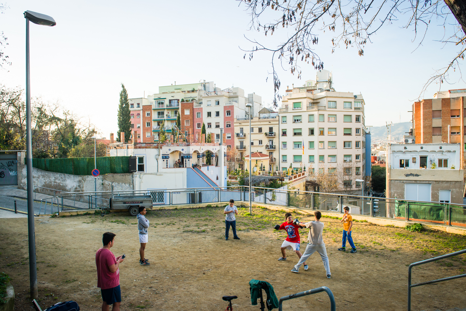 Spain, Barcelona. A group of boys practice boxing in the El Poble-sec neighborhood of Barcelona. The neighborhood has long been a working class and residential haven in central Barcelona, but in recent years has increasingly become a destination for young tourists.