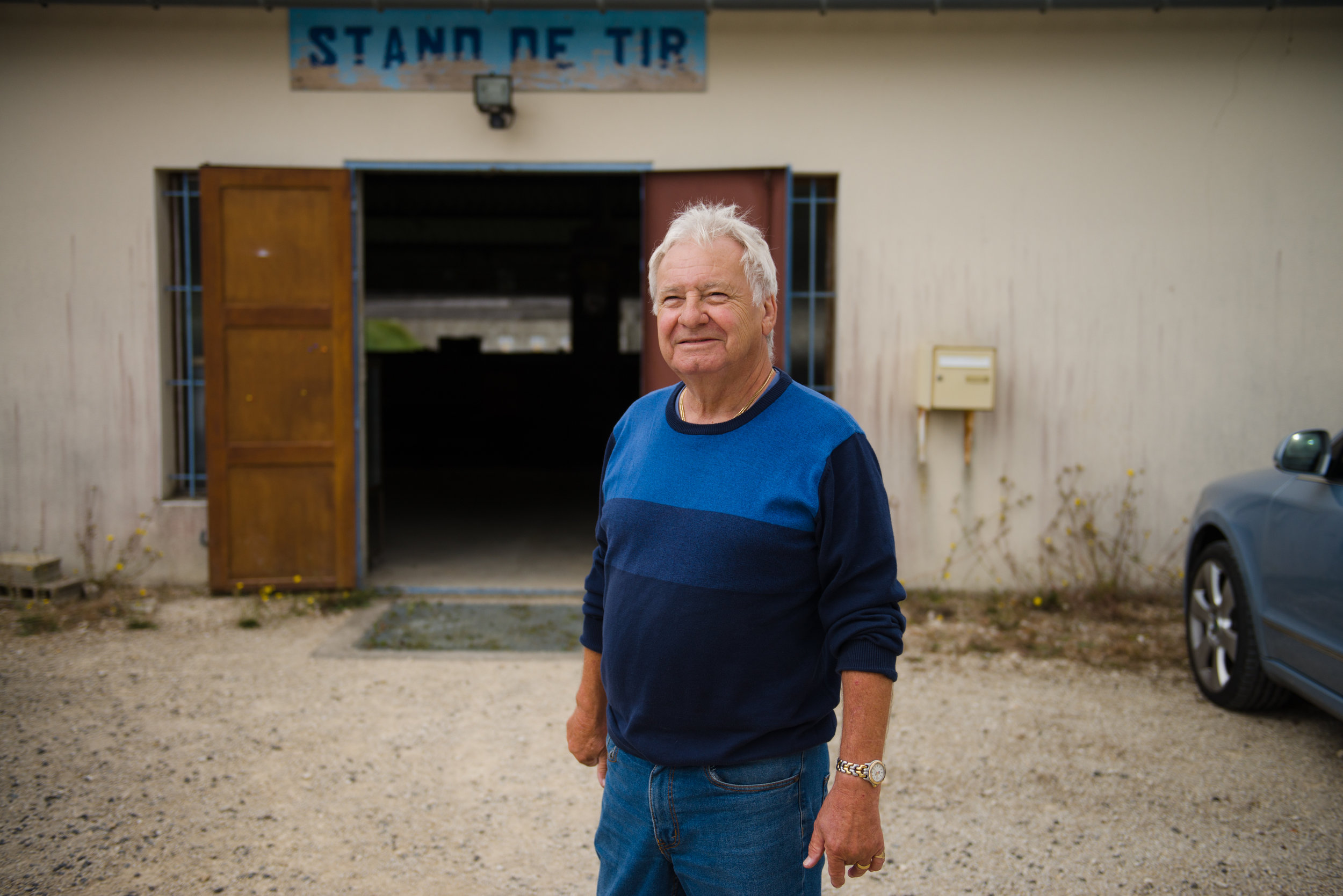 "Ray Garratt, 70, outside La Patriote, a shooting club in Mauprévoir where he and other retired British men go skeet shooting. He and his wife retired to France 6 years ago and are living off their pension and savings. ""The worst thing for us at the moment is that all of our income is in sterling (GBP). We were getting 1.40 per pound to euro and I just changed some the other day and it was 1.06. That is a massive drop in our income."" ""When we came here six years ago no one said to us, well it might change. No one said, well just bare in mind that in five/six years time the UK might decide to leave the EU…they've let us down."""