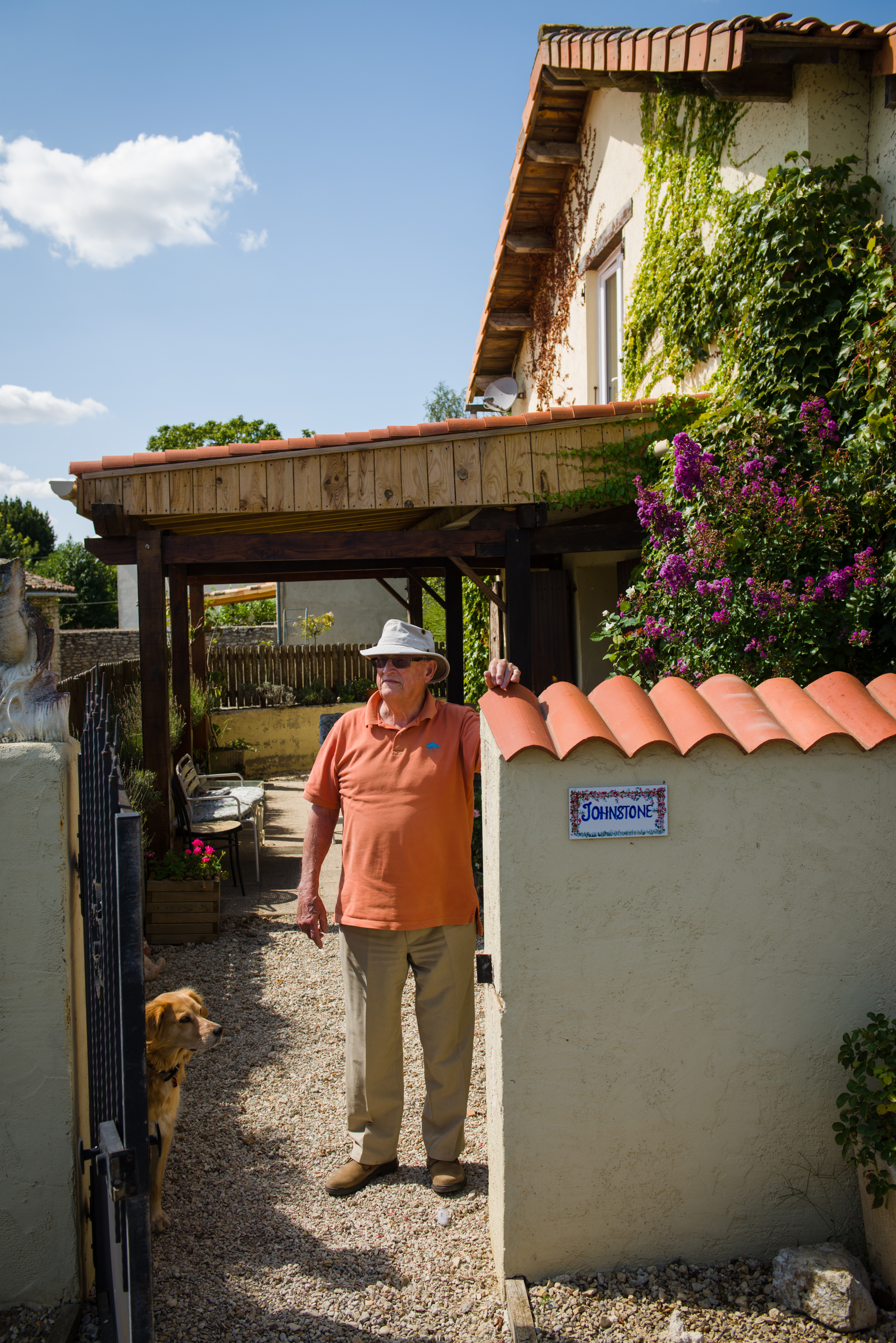 """Alasdair Johnson, 80, outside his home in Linaray, France. Johnson has lived in France for 14 years, his son was educated in France, his wife is active in the village and he is the founding member of a branch of the British Legion serving central France. """"Some people in the UK seem to think we are gin & tonic people all day and all night. We're not, we're busy, we work, we are part of the community here."""""""
