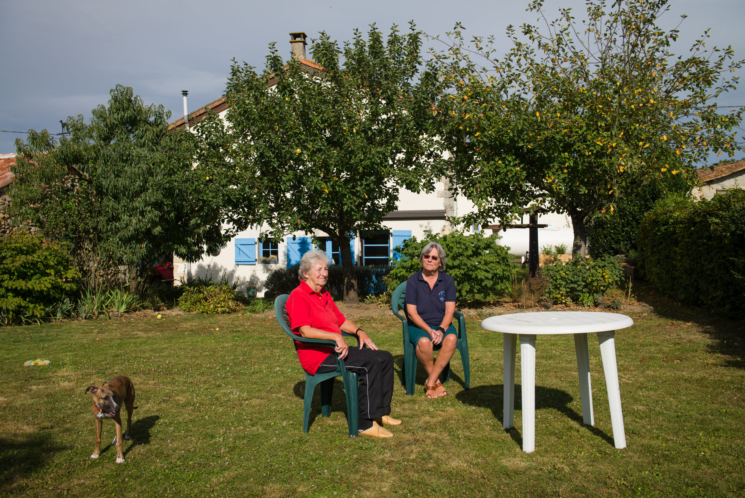 """Dorothea Farquhar (right) and her partner Wendy Wray (left) in the backyard of their home in La Chapelle-Bâton, France. Dorothea and Wendy retired to France in 2015, however only Wendy is of pension age so they both live off that one income (with the exception of some small savings). """"I can not for see of any situation where I would return to the United Kingdom, unless they forcibly eject me,"""" Dorothea said. """"I have no wishes to go back, I have very little family there, I have no ties. We sold our house, we sold our cars. We actually came over in a taxi. We are quite famous as the 2 women who arrived in France, in a taxi, with 3 dogs."""""""