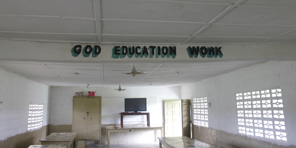 "The Motto of Liberia Mission Painting In A Classroom: ""God, Education, Work"""