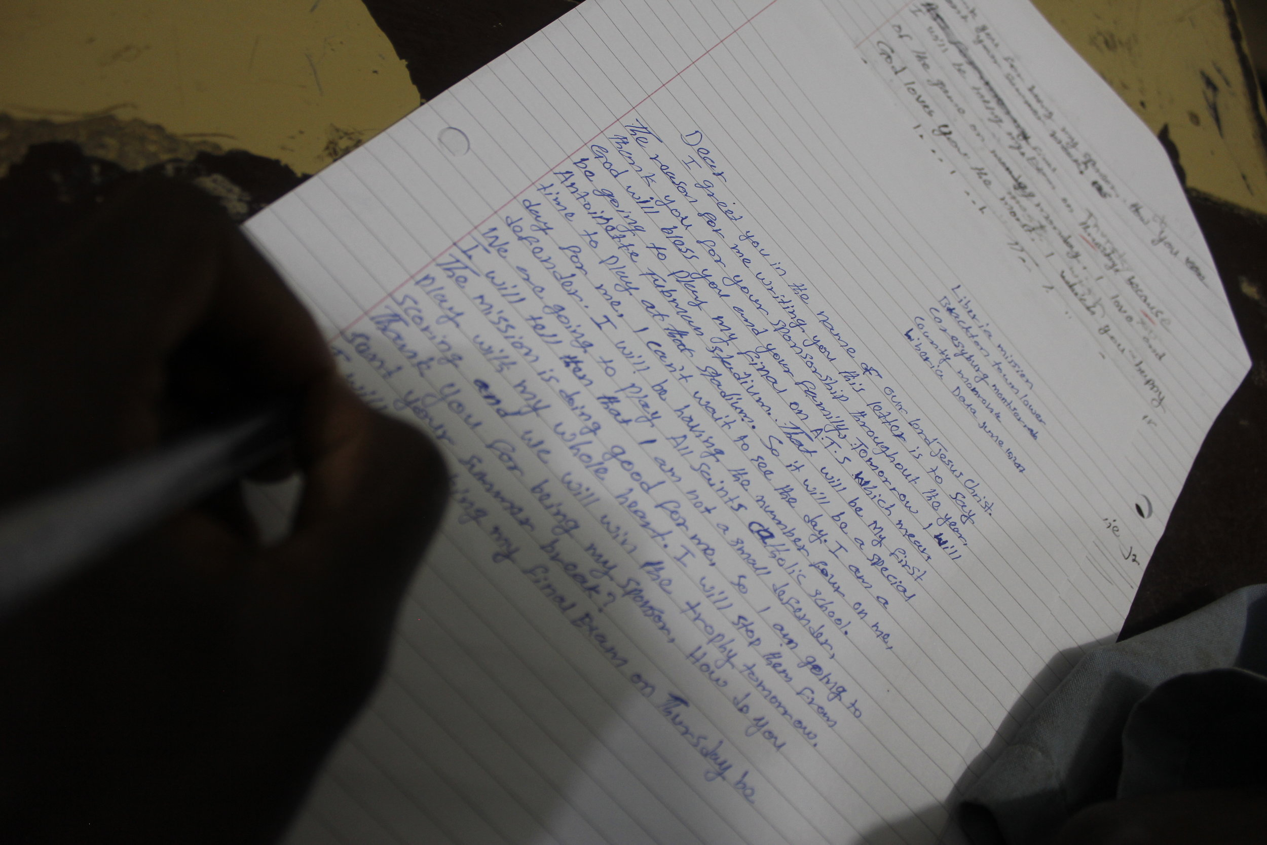 A Student Writing A Letter to their Sponsor