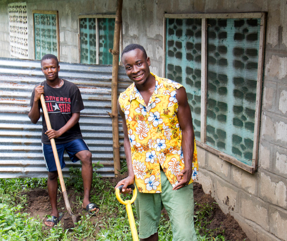 Students digging for irrigation on LMI grounds.
