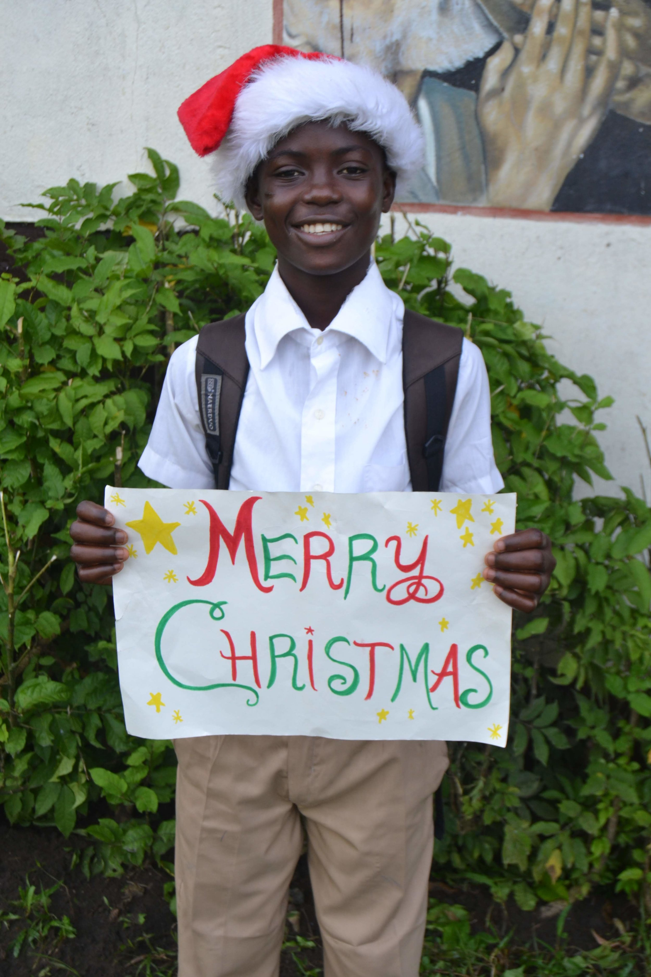 A St. Anthony student sharing Christmas greeting in 2013.
