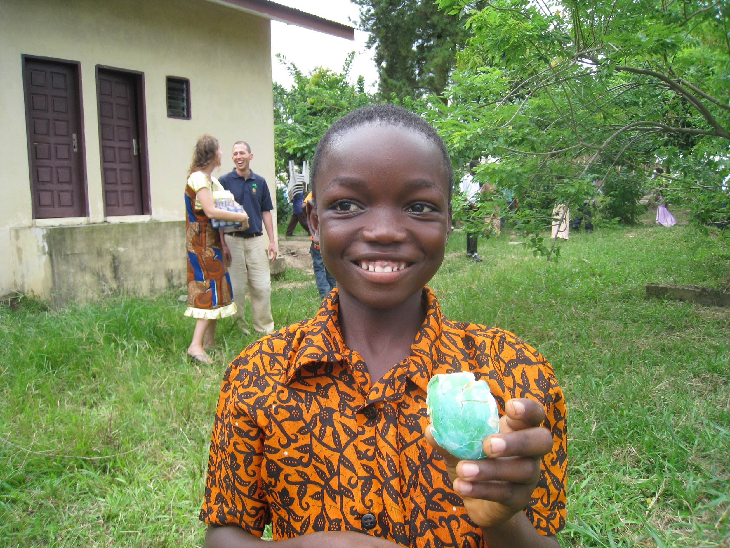 A student successfully hunting eggs for our annual Easter egg hunt in 2011.